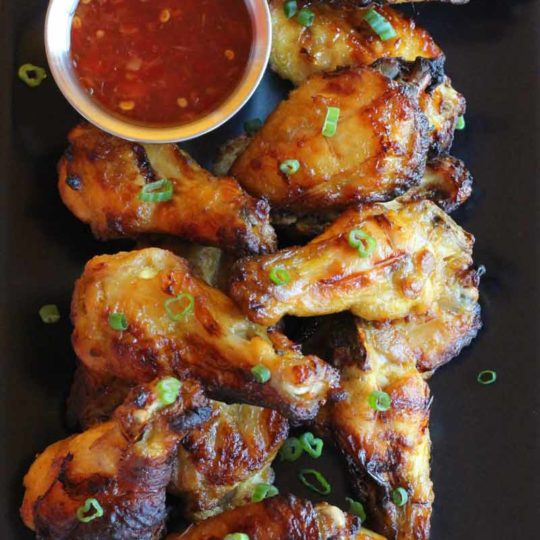 Paleo Glazed Chicken Wings from http://meatified.com. This glaze is fruit based, which means there are no added sweeteners! #paleo #whole30 #autoimmunepaleo #aip #wings #gamefood