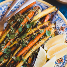 Liven up your roasted vegetables with this punchy green olive dressing! It's quick and easy, pairing perfectly with these caramelized roasted carrots from http://meatified.com.