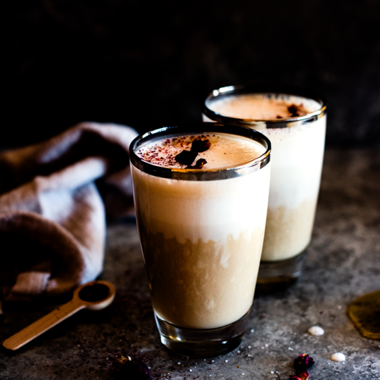 A cozy cup of rose-scented Earl Grey, whipped into a tea latte that's equal parts creamy and comforting. A perfect winter drink from http://meatified.com that's vegan, aip & paleo.