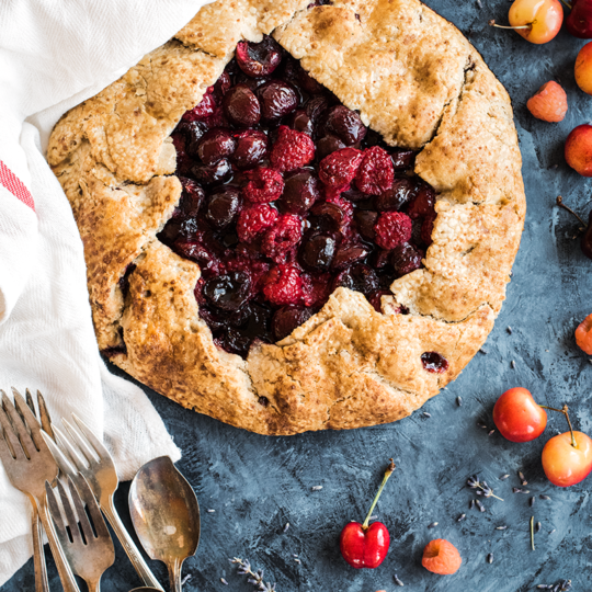 Barely sweetened summer berries & cherries nestle in the flaky, buttery crust wrapped around this cherry galette from https://meatified.com... that just happens to be grain, dairy, egg, nut, seed & coconut free! Oh, and straight up delicious.