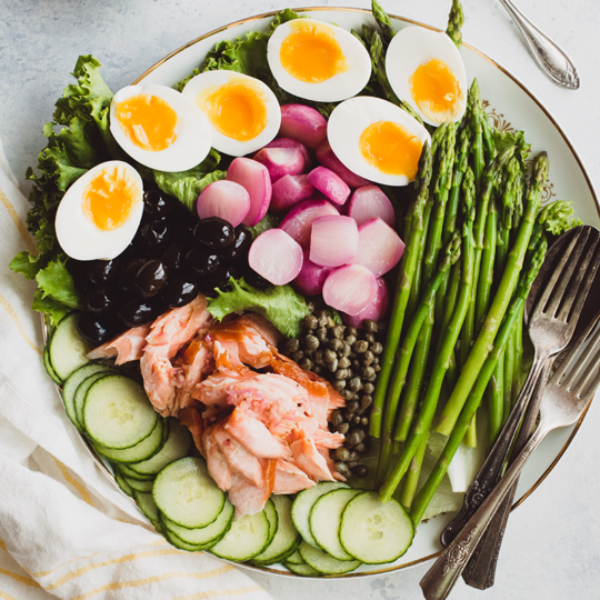 Switch things up with this springtime take on salmon nicoise salad from https://meatified.com, featuring poached radishes, tender asparagus & a punchy lemon shallot dressing.