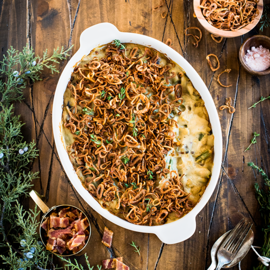 This fresh, vibrant & dairy free take on green bean casserole from https://meatified.com is rich & creamy, topped off with the crispiest (and easiest) fried shallots ever.