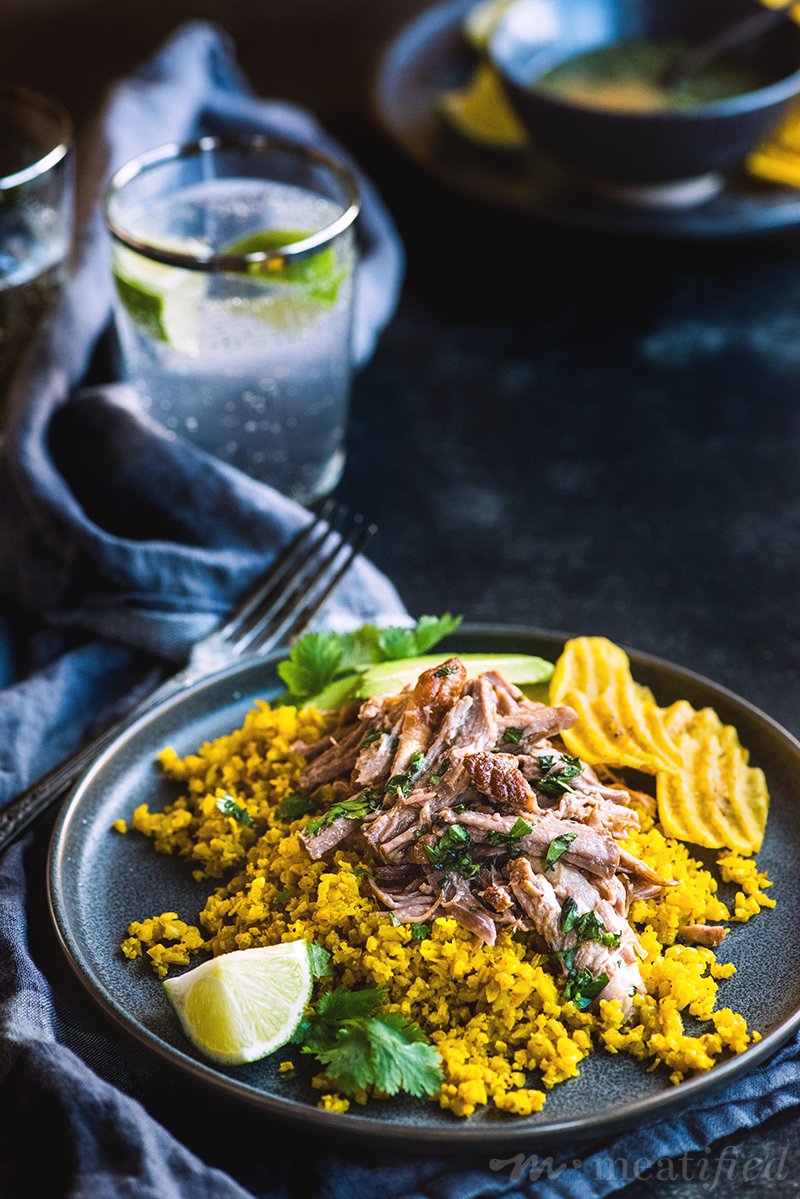 These Cuban pork bowls have tender pork piled on herbed cauli rice, drizzled with citrusy mojo sauce & finished with creamy avocado & crispy plantain chips.