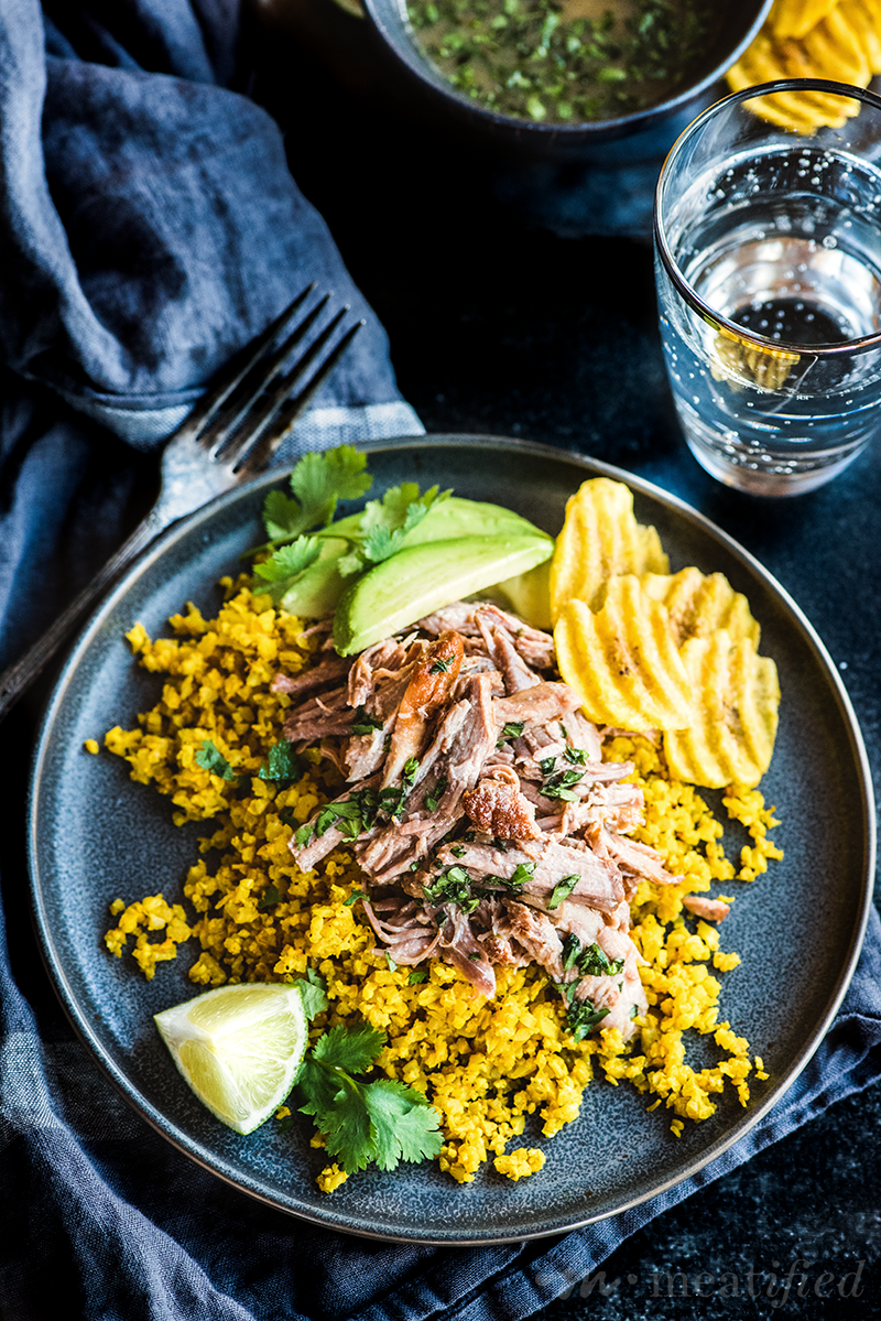 These Cuban pork bowls have tender pork piled on herbed cauli rice, drizzled with citrusy mojo sauce, finished with creamy avocado & crispy plantain chips.