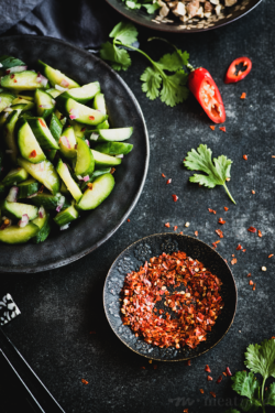 This spicy cucumber salad is a refreshing side for almost every summer meal: crisp vegetables meet spicy sour dressing & a contrasting toasty topping.