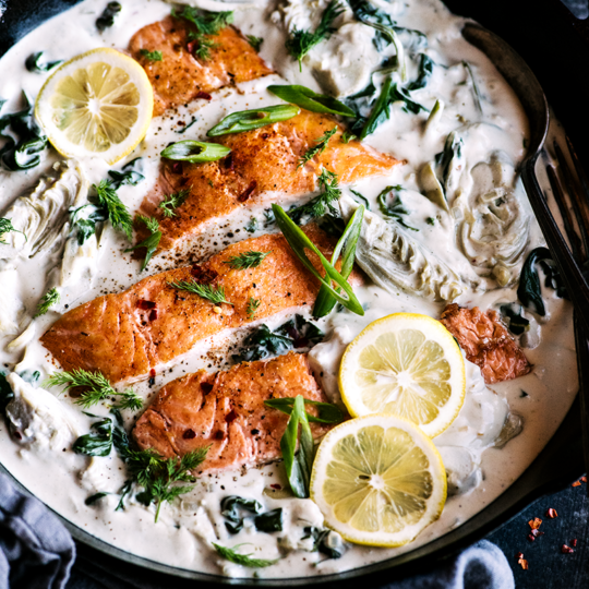 This spinach artichoke salmon takes a speedy spin on classic flavors, turning pantry & freezer staples into a comforting yet healthy weeknight dinner.