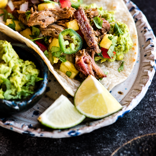 Your new favorite taco is here! These smoked pork carnitas tacos are piled high with crispy seasoned pork & an easy summer inspired pineapple salsa.